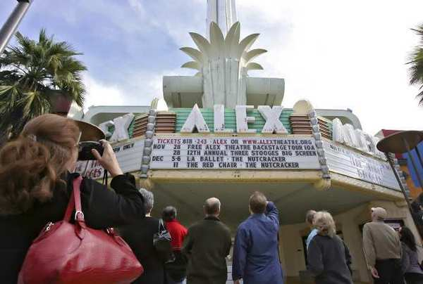 Visitors tour the Alex Theatre in Glendale in 2009. Because the historic structure might be sold, officials have put off renovations.
