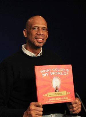 "Former NBA player Kareem Abdul-Jabbar holds a copy of his new children's book, ""What Color is My World?: The Lost History of African-American Inventors,"" in New York."
