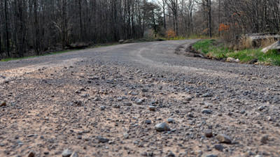 Loose gravel covers Walter's Mill Road Friday near SCI-Somerset. Somerset Township is scheduled to repair the roadway this summer, among others.