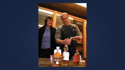 Bob Hansen, a Penn State Extension educator from Bradford County, judges products during the maple king contest Friday at Festival Park. He is assisted by his wife, Bobbie. Matt Emerick of Hyndman won the maple king title, while Walnutdale Maple Farms in Jenner Township won champion syrup.