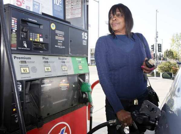 Rosalyn Buchanan fills her tank with gas at a station in Arcadia, Calif. From all corners of the country, Americans are poorer and angrier these days, thanks to the record fuel prices that have soared above $4 a gallon in some states and could top $5 by summer.
