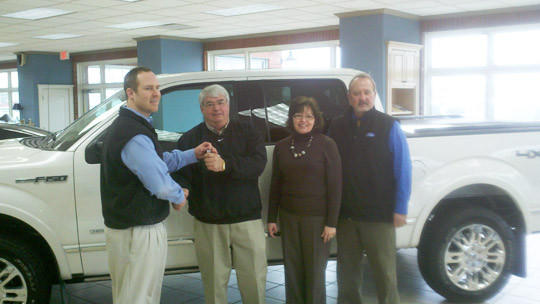 Darrel Kessler of Aberdeen won a 2012 Ford F-150 Crew Cab pickup truck in the nationwide Ford Eco Boost Challenge. From left are Pierson Ford Mercury's general sales manager Kelly Krausz; Kessler and his wife, Lorelie; and Larry Twiss, salesman at Pierson Ford.