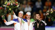 (L-R) Silver medalist Jorrit Bergsma of the Netherlands, gold medalist Bob de Jong of the Netherlands and bronze medalist Jonathan Kuck of the U.S. pose after 10,000 Saturday at the World Single Distance Speed Skating Championships in Heerenveen, the Netherlands.