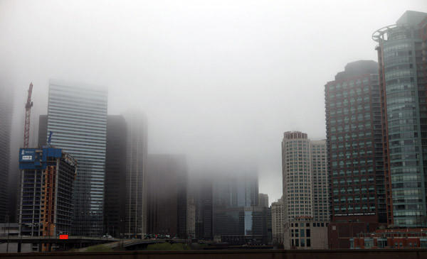 Heavy fog covers downtown Chicago this morning.
