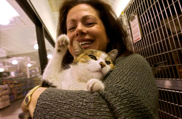 Cherie Travis holds a cat up for adoption in a 2005 photo.