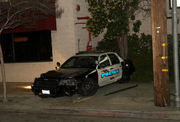 A police car and another vehicle collided in Burbank Friday night.