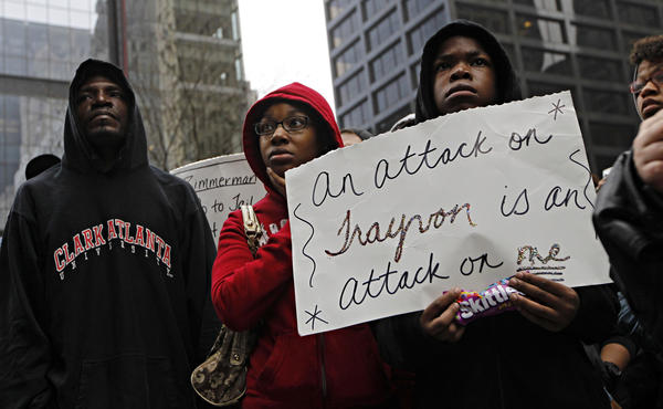 Anthony, Ashley, 21, and Prince Cage, 12, gather during a rally for Trayvon Martin in Daley Plaza on Saturday.