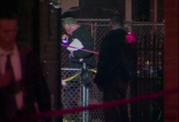 Chicago police search a back yard where a man was shot by an officer early Saturday,