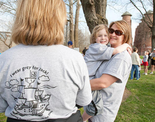 "Robin Dalton, of Allentown, holds son Jack, 5 1/2, as she talks with Jack's teacher Kelley Stout during the 3rd Annual ""Run to Live"" event on the Ironton Rail Trail in Coplay Saturday morning. The event featured an 8K run, 5K walk and 1/2 mile ""fun Run"" for kids with proceeds benefiting the Pediatric Cancer Foundation of the Lehigh Valley."
