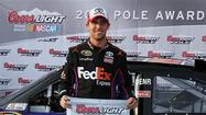 Denny Hamlin has won the pole at Auto Club Speedway, with teammate Kyle Busch joining him in the top two spots for Sunday's race.