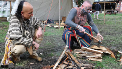 Native American Indians and re-enactors Ghost in the Head and Smoke in the Sky prepare a fire Saturday at the 65th annual Pennsylvania Maple Festival.