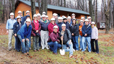 Despite the rainy weather on Saturday, the Deer Valley YMCA board of directors, committee members and volunteers gathered for their family cabin ground breaking on their 742-acre campground in Fort Hill.