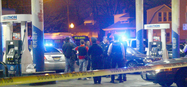 Police at a crime scene at 7100 S. Damen Avenue on March 24, 2012. A man drove here after getting shot eight blocks south on Damen Avenue, one of at least eight overnight shootings.