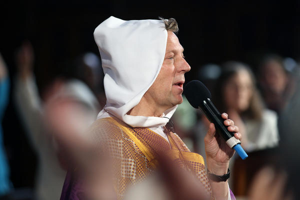 Rev. Michael Pfleger wears a hoodie in tribute to Trayvon Martin during a mass at St. Sabina Church in Chicago Sunday. Martin, an African-American teenager fatally shot in Florida by a man on neighborhood watch, was wearing a hooded sweatshirt when he was killed.