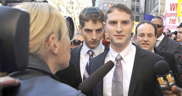 Avi Werdesheim, 20, and, Eliyalu Eliezer Werdesheim, 23, charged with assaulting a black teenager while members of Shomrim, a Jewish neighborhood patrol group, leave the Circuit Court after their arraignment.