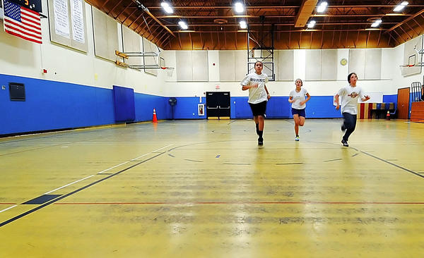 From left, Davon Anders, Keisha Mumma and Justin Beckley run on the gym floor at Springfield Middle School in Williamsport in this Jan. 29 file photo.