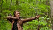 "Lionsgate hit a bull's-eye with ""The Hunger Games"" this weekend, as the story of expert archer Katniss Everdeen and her battle for survival debuted with a record-breaking $155 million at the box office."