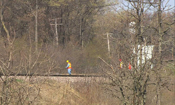 Workers on the scene where a man's body was found on Metra tracks in Lake Forest Sunday morning.