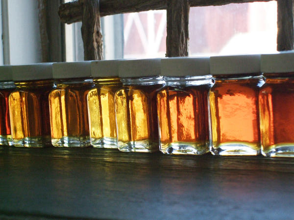 Maple syrup lines the window sill of Parsons Centennial Farm in Charlevoix.
