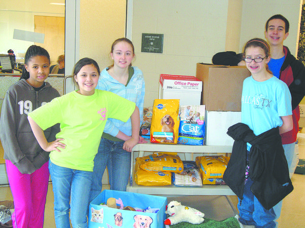 Members of the Smithsburg Middle School Gives Back Extension Club recently visited the Humane Society of Washington County, where they presented student-made pet toys and collected donations. From left, are Jasmine Cham, Katrina Celestial, Mary Wesmiller, Karen Pastwa and Noah Stottlemyer.