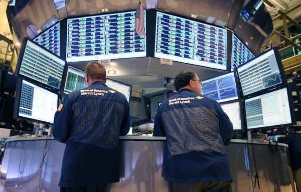 Bank of America Merrill Lynch traders work on the floor of the New York Stock Exchange, where there are fewer and fewer traders because of the dominance of computer trading. Will the BATS glitch on Friday change that?