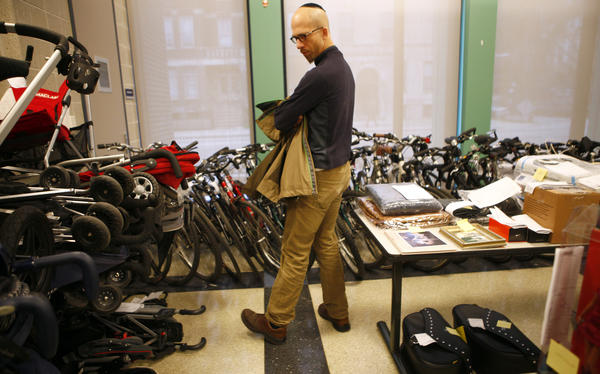 Theft victim Jeremy Treister looks over some of the over 150 bicycles allegedly stolen by 32-year-old Jicheng Liu over a two-year period and found by police March 13th in his Lincoln Park home and in four storage units. The bicycles, along with hundreds of items valued at about $500,000 including about 70 golf club sets, 100 strollers, 500 packages and over 70 garage door remotes used in the robberies, are on display this week for recovery by victims who can prove ownership at the Chicago Police Department Town Hall  (19th) District Station, 850 W. Addison St..