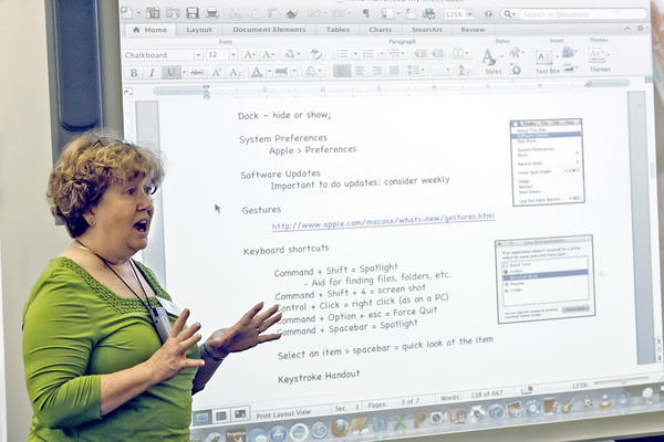 GUSD's Katie Warren shows a group of teachers the ins and outs of the OS X Lion on new MacBooks Pros purchased with Measure S funds on Monday, March 26, 2012.