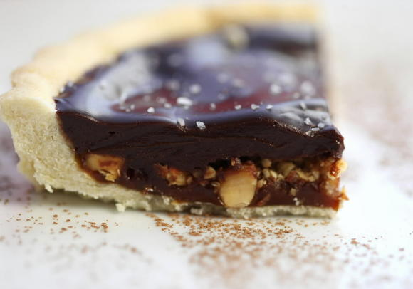 Salted caramel tart in a rich sweet pastry