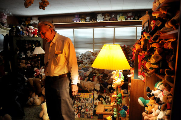 "Jerry Gamble stands among over 2500 teddy bears his late wife, Jean Gamble, collected over 12 years in their Delray Beach home Monday afternoon. "" It doesn't make any sense to have them any more, "" said Gamble who was married to his wife, Jean, for 53 years. Gamble and his sons have already given away about 500 teddy bears to a church, hospice and a nursing home, but would like to give away more or sell them. ""I rather give it to a worth cause. There's a lot of needy kids who need a teddy bear."""