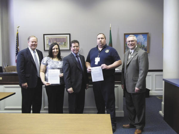 The Franklin County (Pa.) Commissioners recently recognized two 911 dispatchers for their efforts. From left are Commissioner Bob Ziobrowski, dispatcher trainee Julianne C. Schrecengost, Commissioner David Keller, dispatcher Robert P. Brown and Commissioner Bob Thomas.