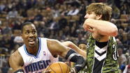 <b>Pictures: </b> Magic beat Raptors on the road