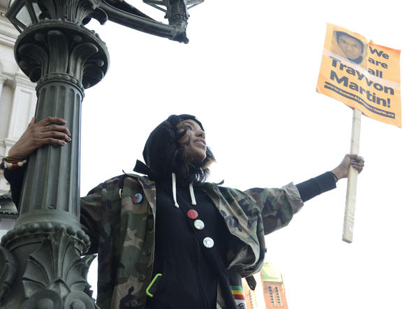 Gloria Leandry, 21, from Edgewood, stands on a lamp post at City Hall during a rally sponsored by the NAACP, the Maryland Southern Christian Leadership Council and the Baltimore National Action Network. The rally began at Pratt and Light Streets and marched to City Hall in memory of Trayvon Martin, the 17-year-old who was unarmed when he was shot and killed Feb. 26 in Sanford, Fla.