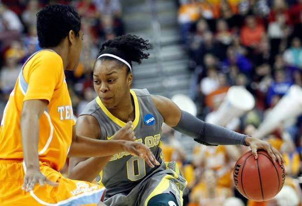 Baylor Lady Bears guard Odyssey Sims (0) dribbles around Tennessee Lady Volunteers guard Kamiko Williams (4) during the second half of the finals of the Iowa region in the 2012 NCAA women's basketball tournament at Wells Fargo Arena.