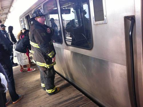 "Chicago firefighter on the Bryn Mawr Avenue ""L"" platform, where a man fell in front of a train Monday afternoon. Person falls on tracks, halts CTA Red Line service."