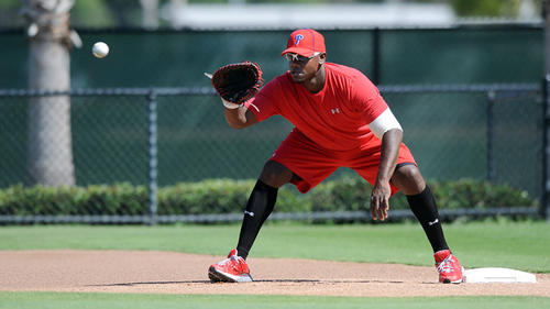 Philadelphia Philles first basemen Ryan Howard works out with Phillies coach Sam Perlozzo (not in photo) with his foot work around first base during morning work outs in Clearwater FL. Tuesday morning.
