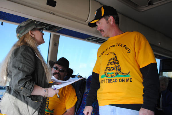 Hagerstown Tea Party Vice President Lynda Evans, left, her husband Grover, center, and President Don Hineman, right, get ready to leave for Washington, D.C. Tuesday morning with Tea Party members for the Hands Off Our Healthcare Rally.