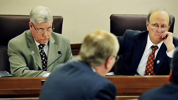 Washington County Commissioners John Barr, left, and William McKinley listen to Washington County Public School's Chief Financial Officer Chris South present the school board's budget on Tuesday.
