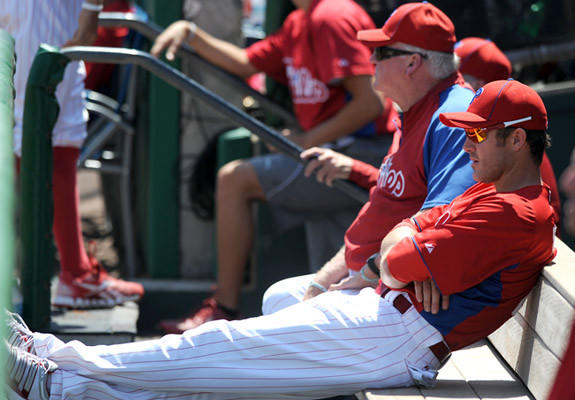Philadelphia Phillies' manager Charkie Manuel and second basemen Chase Utley watch the game from the doug out Tuesday afternoon in Clearwater.