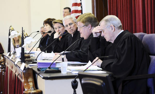 The West Virginia Supreme Court of Appeals, from left: Justice Margaret L. Workman, Justice Robin Jean Davis, Chief Justice Menis E. Ketchum II, Justice Brent D. Benjamin and Justice Thomas E. McHugh heard arguments in a total of four cases with an audience of local students in Jefferson County Circuit Court Tuesday morning as part of court's Legal Advancement for West Virginia Students (LAWS) program.