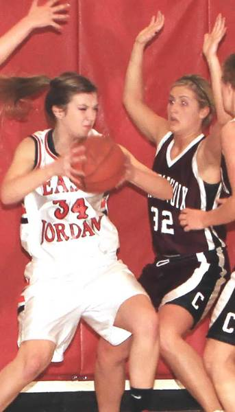 Grace Howes (left) of East Jordan and Kelsey Way of Charlevoix each earned a spot on the All-Lake Michigan Conference girls basketball team for the 2011-12 season.