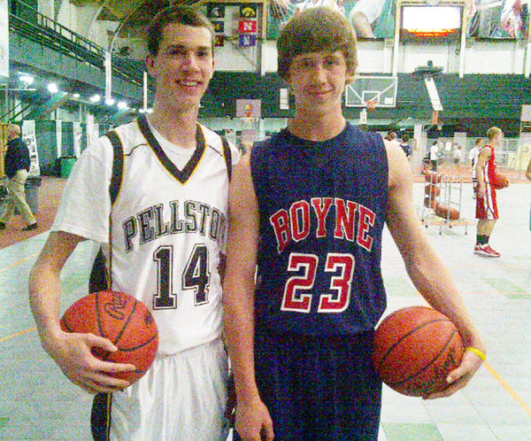 Pellston senior Chrisopher Hass (left) and Boyne City sophomore Ryan Carson stand together at Michigan State University's Jenison Fieldhouse Saturday during the Basketball Coaches Association of Michigan State Free Throw Championship. After surviving the opening two rounds at Jenison, the pair moved over to the Breslin Center for the final, during which Carson defeated Hass.