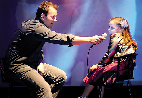 "Jeremy Ellis of Hagerstown, left, interviews his daughter, Briana, 6, Tuesday night at Leitersburg Cinemas prior to the viewing of Jeremy's ""Wheel of Fortune"" debut."