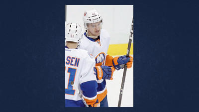 New York Islanders' Michael Grabner (40) celebrates his first-period goal with teammate Frans Nielsen (51) during an NHL hockey game against the Pittsburgh Penguins in Pittsburgh on Tuesday.