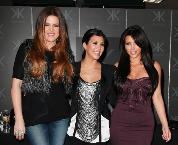 (L to R) Khloe, Kourtney and Kim Kardashian attend an in-store appearance for the Kardashian Kollection at Sears September 18, 2011 in Cerritos, Calif.