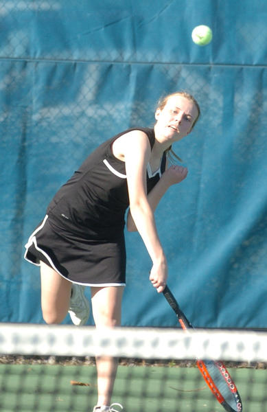 Boyle Countys Sarah Nolan won at singles and doubles for the Rebels Tuesday in a 5-4 win over Danville.