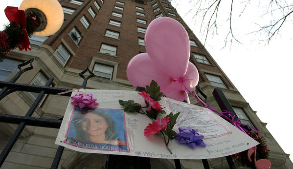 Photos, notes and balloons make up a memorial outside the building on North Winthrop Avenue in Januray 2005, where Melissa Dorner lived.