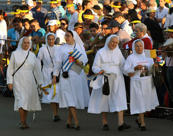 Cuban nuns head to their seats before the start of a mass by Pope Benedict XVI, in Revolution Square in Havana on March 28, 2012. Pope Benedict XVI was to meet Fidel Castro as he wraps up a three-day visit.