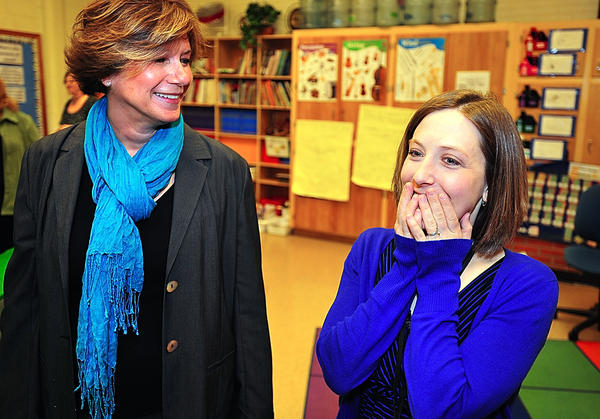 Fountaindale School for the Arts and Academic Excellence music teacher Jennifer Roberts, right, reacts to the news that she is the recipient of a $895 mini-grant from the Washington County Public Schools Foundation. The money will go to buy an Apple iPad and applications that will assist students in music composition. School principal Teri Williamson, left, brought Roberts from her office to receive the news.