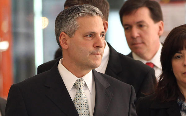 John Harris, former chief of staff for former Gov. Rod Blagojevich, leaves the Dirksen U.S Courthouse after his sentencing was postponed on March 16, 2012.