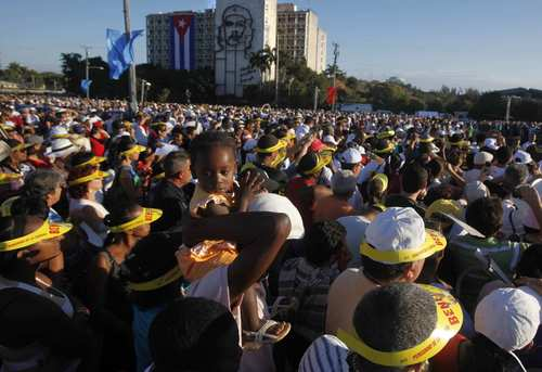 Pope Benedict XVI celebrated Mass in Havana's Plaza de la Revolucion on Wednesday morning. Thousands turned out for the ceremony, many from countries throughout Latin America. A young girl is held above the crowd at the beginning of the service.